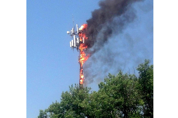 Cell communications tower on fire